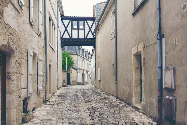 Narrow alley in an old town in cognac, france