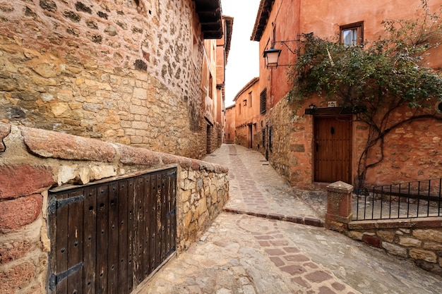 Narrow alley with old stone houses in medieval style in the town of albarracã­n, teruel aragã³n. spain.