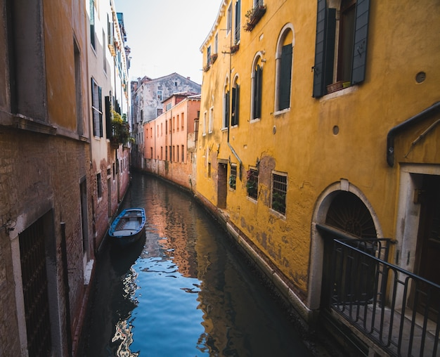 Narrow canal in the middle of buildings in venice italy