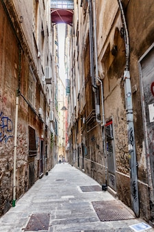 Narrow street in the center of the old city. traditional european architecture. vertical.