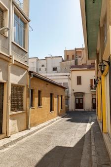 Narrow street in european old town. vertical.