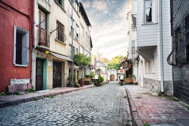 Narrow street lined with stone