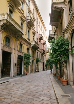 Narrow street of the old medieval city of italy, beautiful architecture of houses, streets in paving stones.