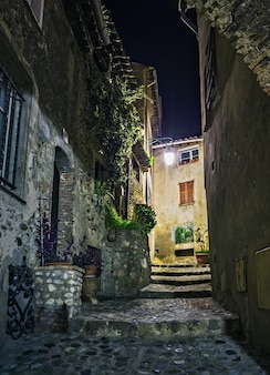 Narrow street in the old town in france at night