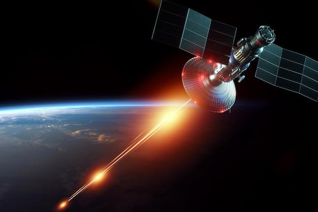 宇宙軍事衛星、宇宙の武器は地球の壁にレーザーを撃ちます。攻撃、テクノロジー、宇宙戦争。混合培地、コピースペース。 nasaから提供された画像。