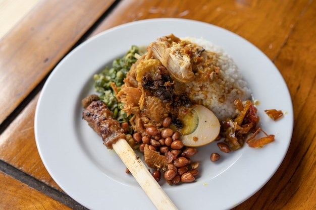 Nasi campur with sate lilit delicious authentic dish