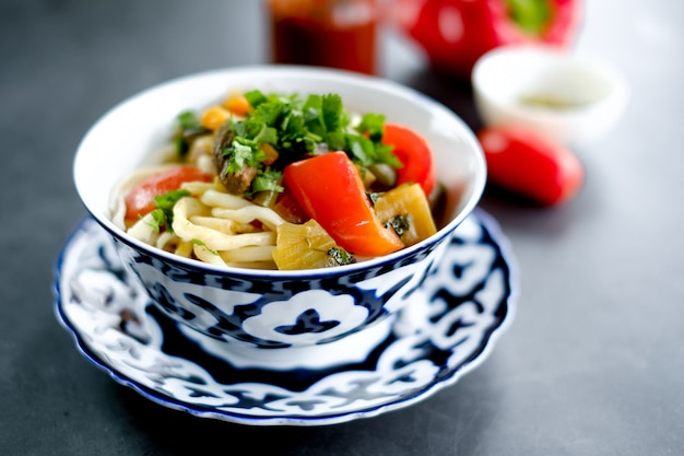 National asian tasty  dish lagman in a plate on table