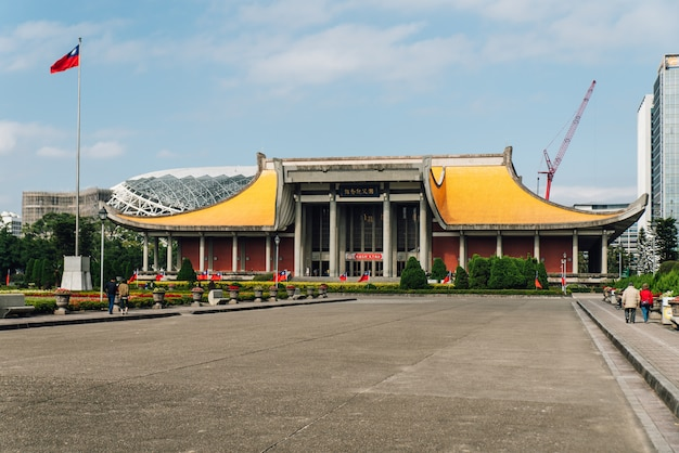 The national dr. sun yat-sen memorial hall with blue sky and cloud and construction crane in taipei, taiwan.
