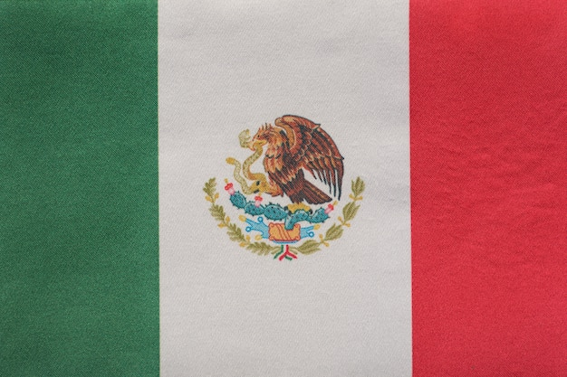 National emblem of mexico close up. tricolor green, white, red and coat of arms
