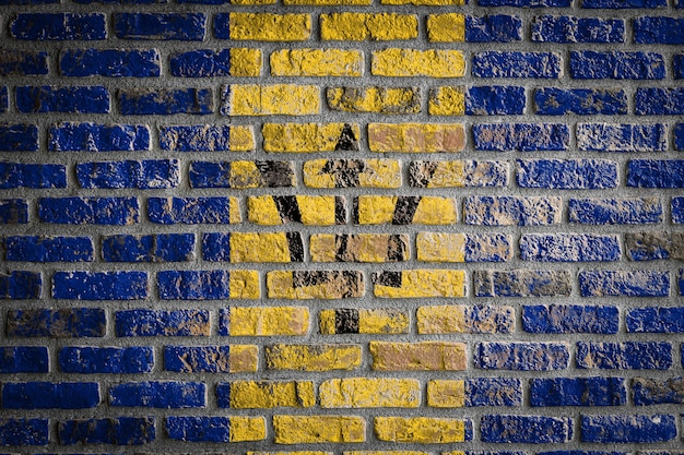 National flag of barbados   on an old brick wall