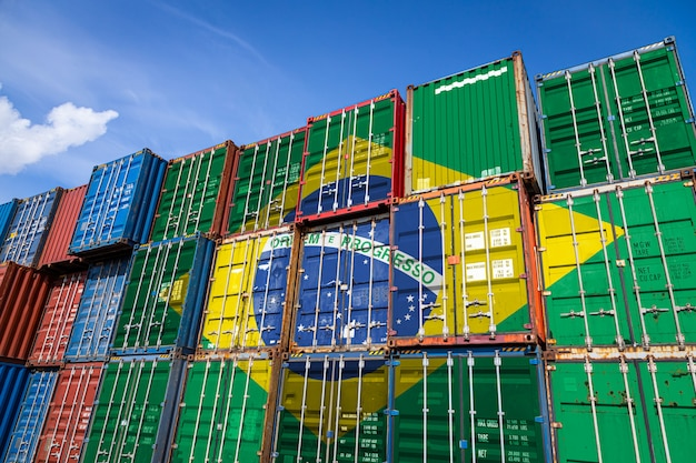 National flag of brazil on a large number of metal containers for storing goods stacked in rows