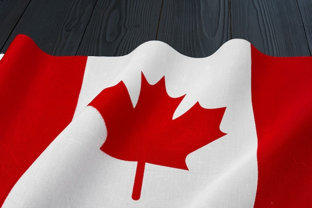 National flag of canada on wooden background, copy space