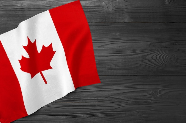 National flag of canada on wooden surface