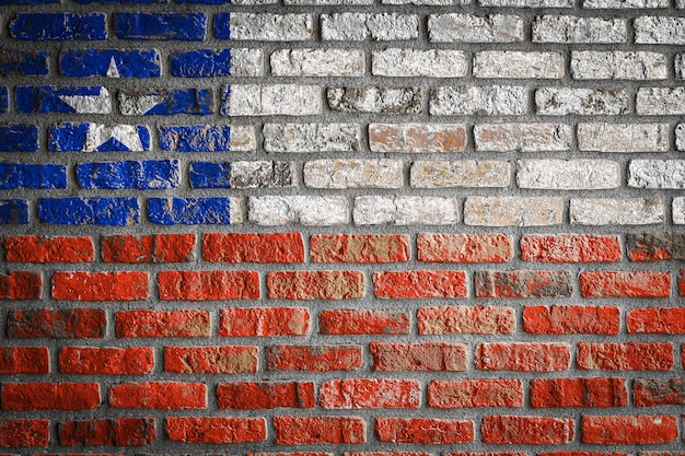 National flag of chile  on an old brick wall
