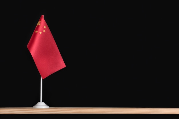 National flag of china on black surface. red flag with stars. copy space.