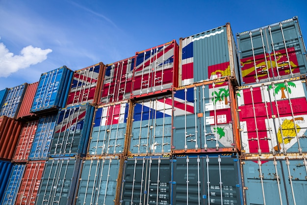 National flag of fiji on a large number of metal containers for storing goods stacked in rows