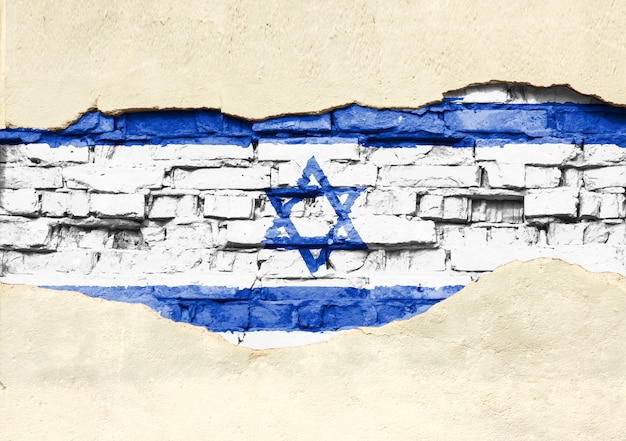 National flag of israel on a brick background. brick wall with partially destroyed plaster, background or texture.