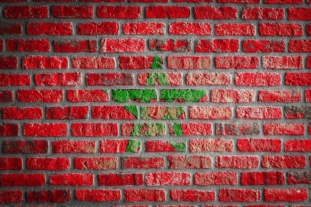 National flag of morocco  on an old brick wall