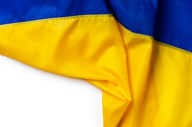 ウクライナのファブリックテキスタイルの背景の国旗をクローズアップ