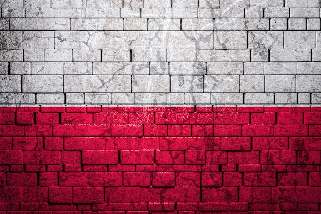 National flag of poland on brick wall background.