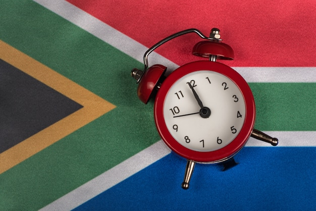 National flag of republic of south africa and alarm clock