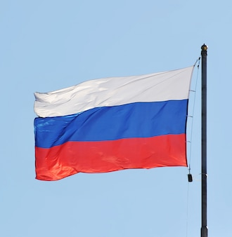 The national flag of russia on the sky background