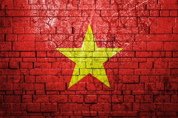 National flag of vietnam on brick  wall.the concept of national pride and symbol of the country.