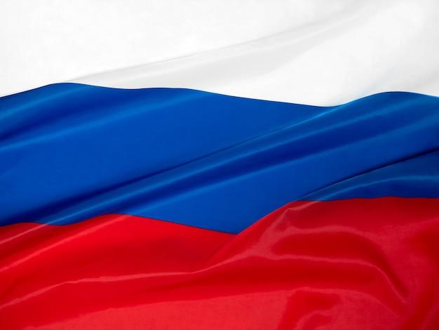 Национальный праздник 12 июня - день россии. российский флаг крупным планом.