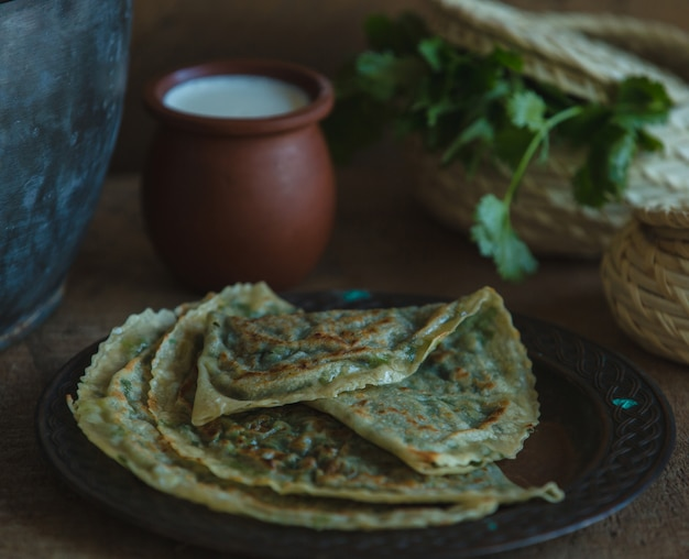 National lavash kutab served with a pot of yogurt.