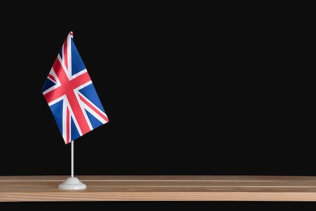 National table flag of uk on black studio Premium Photo