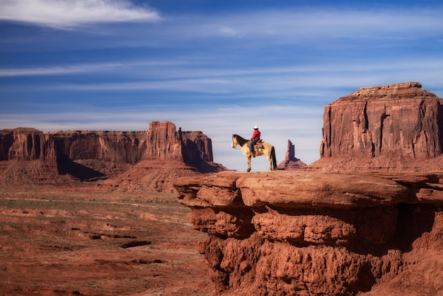 Native american riding horse in monument valley