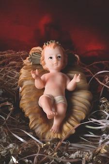 Nativity scene. baby jesus figure isolated. traditional christmas scene.