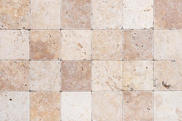 작은 사각형 부품의 자연석 벽 배경 또는 내부 질감