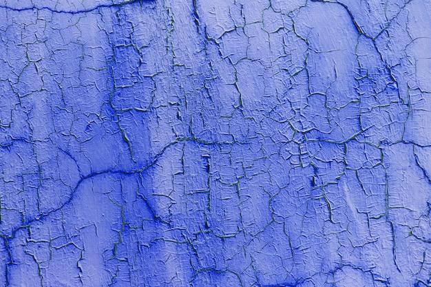 팬텀 블루 색상의 질감 된 금이 벽의 자연 추상적 인 배경.