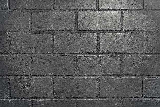 黒レンガの壁の自然な抽象的なテクスチャ背景。