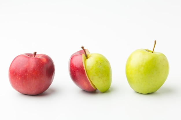 Natural apples aligned on table
