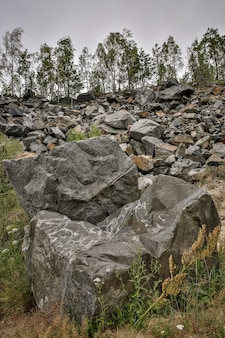 Natural background wall made of rock stones.