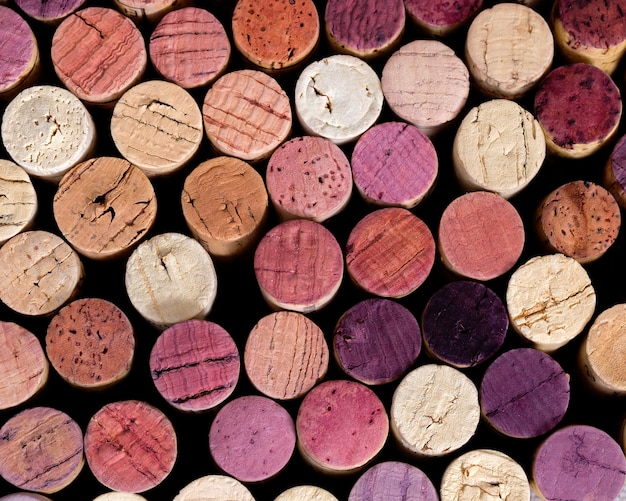 Natural background of wooden plugs in different shades and colors.