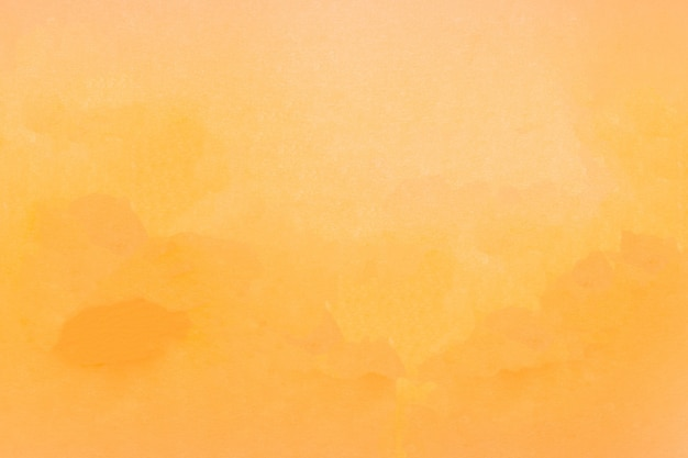 Natural background of yellow orange textured paper.