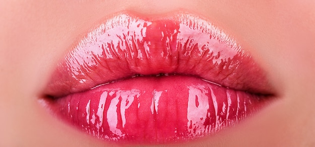 Natural beauty lips. sexy female lips with pink lipstick. sensual womens open mouths. red lip with glossy lipgloss. close up, macro with beautiful mouths. girl lipstick.