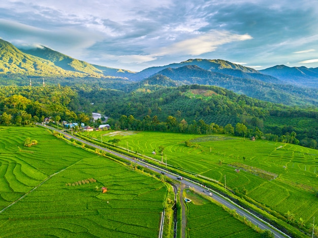 The natural beauty of mountains, fields and sky. green indonesian natural landscape in the bengkulu area with aerial photographs