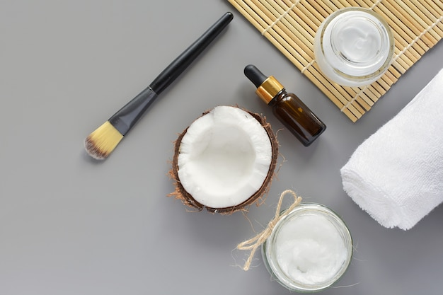 Natural beauty, skin care products, cosmetic coconut oil, body lotion, modern flat lay.