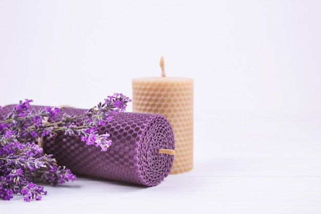 Natural beeswax candles with lavender flowers