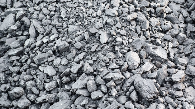 Natural black charcoal texture for background, fuel for coal industry
