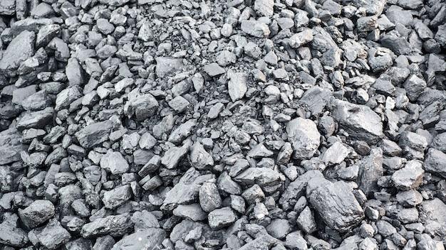Естественная текстура черного древесного угля для фона, топлива для угольной промышленности