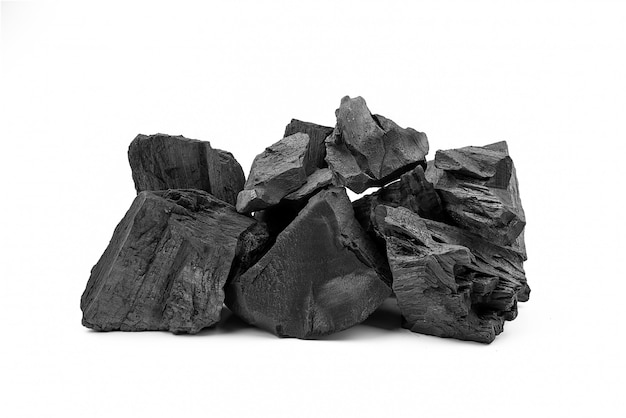 Natural black wooden charcoal isolated on white background.