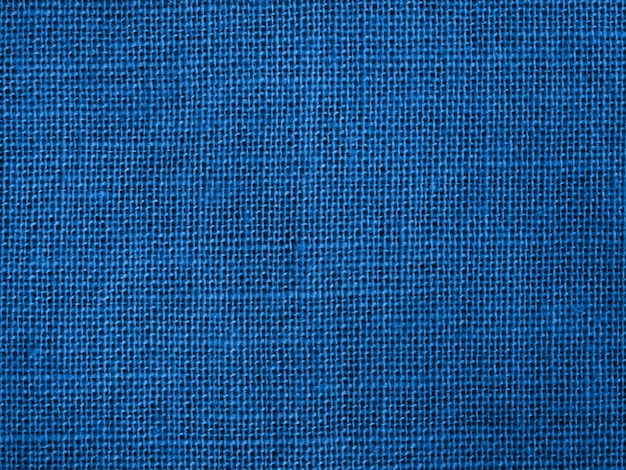 Natural blue cotton fabric weaving as color of 2020 background.