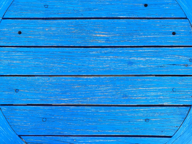 Natural blue wood panels table texture wall background.