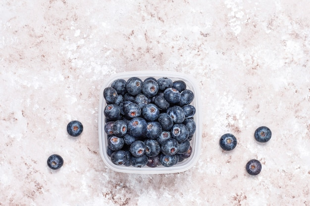 Natural blueberries on light brown background,top view,copy space