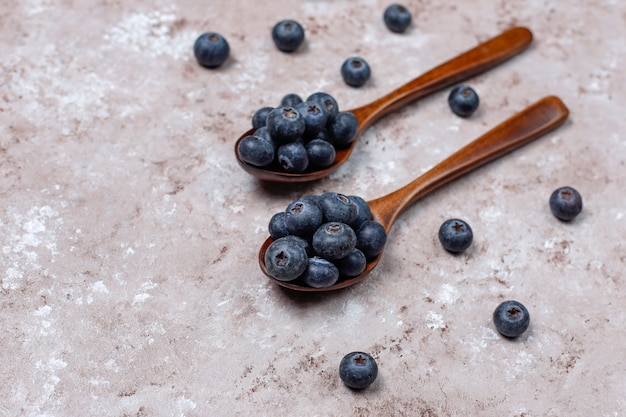 Natural blueberries on light brown surface,copy space